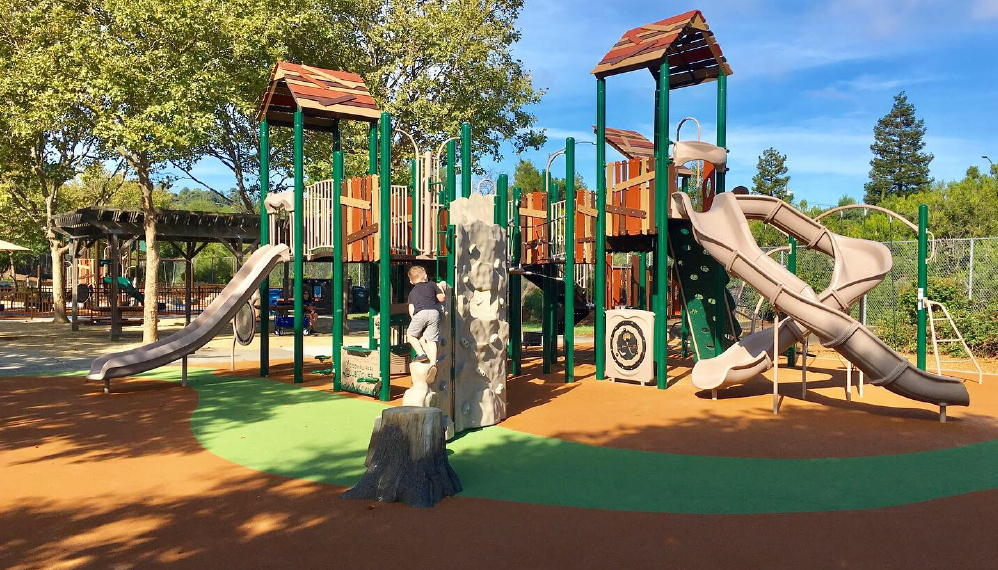 playground with three slides, rubber surfaces to land on