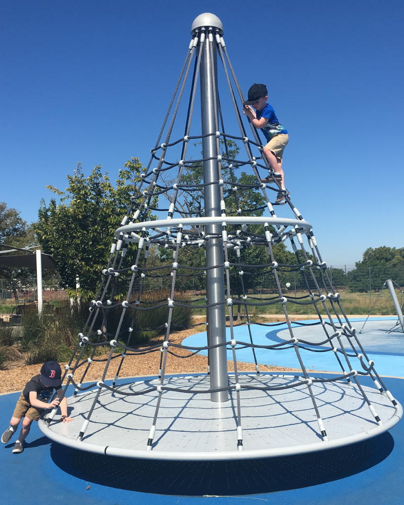 merry go round climbing structure with ropes